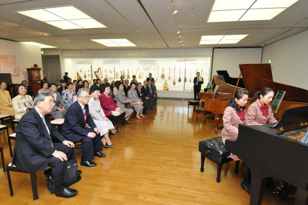 Guests at the opening ceremony enjoy the classical sounds of an antique fortepiano