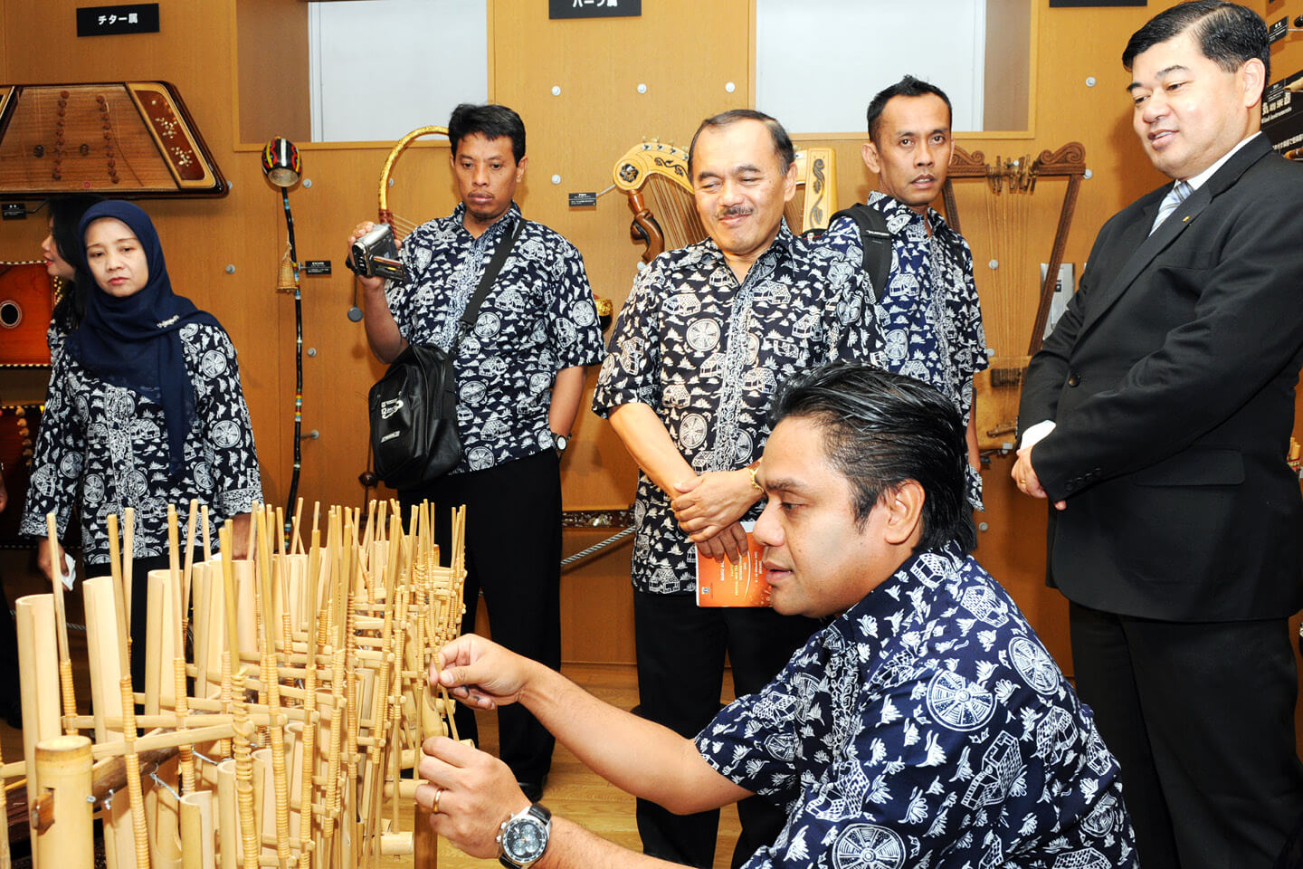 A member of institute plays an Indonesian Angklung on display in the Music Museum
