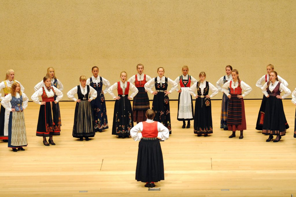 The Norwegian Girls Choir performing in traditional national costume